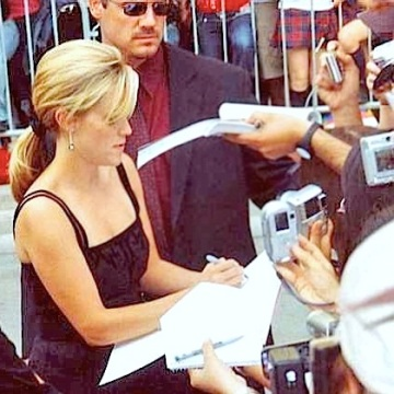 Reese Witherspoon signing autographs